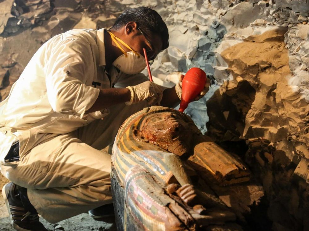 An archaeologist restores a sarcophagus in the recently discovered tomb of Amon's goldsmith Amenemhat near Luxor in southern Egypt. IBRAHIM RAMADAN / ANADOLU AGENCY