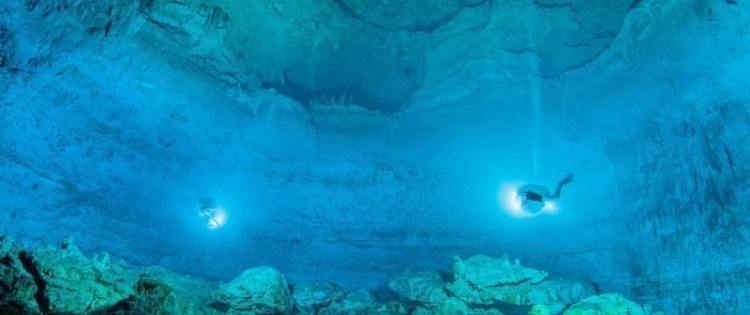 A photo dated May 13, 2012 and published on May 15, 2014 by the National Institute of Anthropology and History of an exploration of the Hoyo Negro Underwater Cave, Mexico. INAH/AFP/Archives - ROBERTO CHAVEZ ARCE